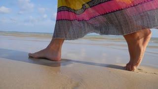 Female Legs Walking on Beach in Sunset Summer Light