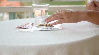 Female Taking Medicine. Many Pills and Glass of Water.