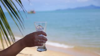 Female Tourist on Beach with Icy Drink. Vacation. Slow Motion