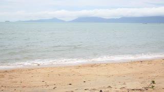 Female Walking on Tropical Beach.