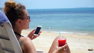 Female with Phone in Happy Summer Holidays on Beach