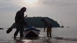 Fishermen With Fishing Boat on Beach in Thailand.