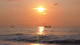 Fishing Boat at Sunset in Sea