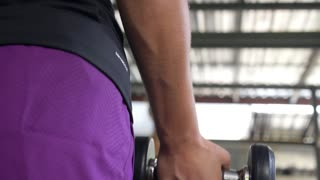 Fitness Female Hands with Dumbbells Doing Exercise in Gym