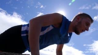 Fitness Sport Man Exercising Push Ups in Cross-Training.