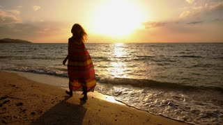 Free Happy Romantic Woman Walking on Beach at Sunset. Slow Motion.