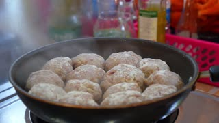 Frying Pork Meatballs or Cutlets in Sizzling Hot Pan
