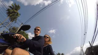 Funny Couple in Love on Motorbike Driving Together. Slow Motion.
