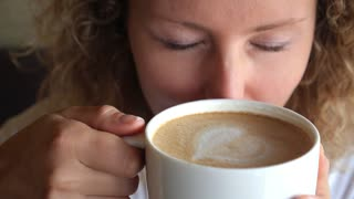Funny Woman with Crazy Eyes Looking at Coffee Cup. Caffeine Addiction