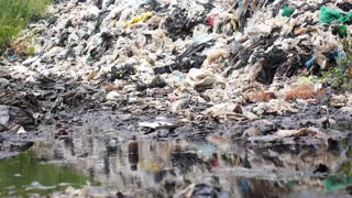 Garbage on Landfill Site Pollute River and Damage Environment