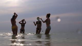 Girl Friends in Bikini Dance on Beach in Summertime