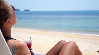 Girl in Bikini Drinking Juice on Sandy Sunny Beach in Holidays