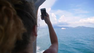 Girl on Cruise Ship Taking Selfie Sailing in Sea. Slow Motion.