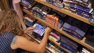 Girl Shopping in Clothing Store in Shopping Mall