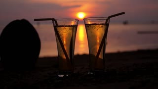 Glasses at Romantic Sunset on the Beach