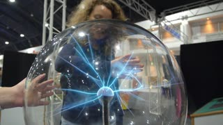 Hand on Plasma Globe or Sphere with Electric Beams