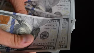 Hands Counting Dollar Bills Closeup
