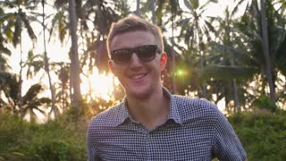 Handsome Young Man Dancing at Sunset. Slow Motion.