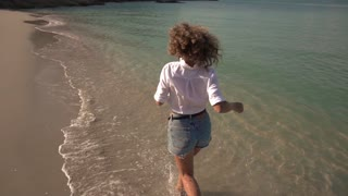 Happy Beautiful Woman Running on Beach. Slow Motion. 250fps.
