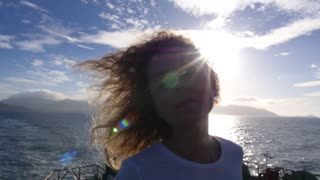Happy Carefree Woman Sailing in Sea Against Blue Sky. Slow Motion