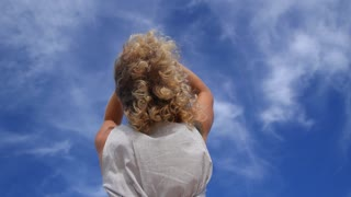 Happy Curly Woman Against Blue Sky Outdoors