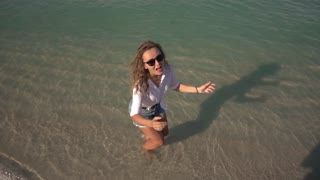 Happy Girl Jumping on Beach. Slow Motion. 250fps