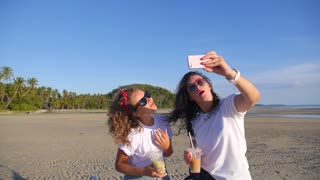 Happy Girls Taking Selfie with Mobile Phone at Beach