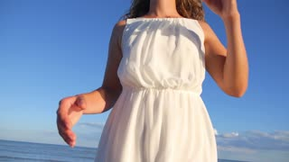Happy Lifestyle of Woman in White Dress Against Blue Sky