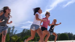 Happy Lifestyle of Young Girls Running on Beach