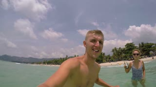 Happy Man Diving Into Sea with GoPro on Vacation