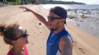 Happy Success Lifestyle - Couple Cheering on Beach