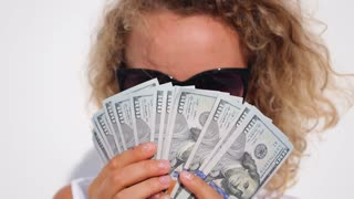 Happy Successful Woman Holding Dollars - Money Power and Wealth