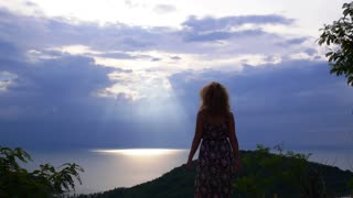 Happy Woman Reaching the Top and Enjoying the Sea View. Slow Motion.
