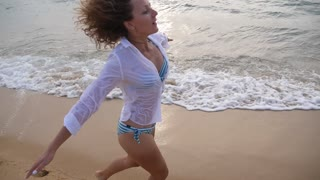 Happy Woman Running on Beach of Tropical Island