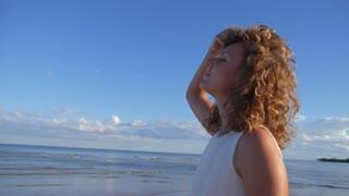 Happy Woman Walking on Beach on Summer Vacation