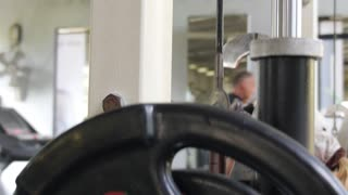 Healthy and Active Lifestyle - Female Lifting Weights in a Gym