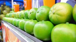 Healthy Organic Green Oranges at Market