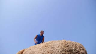Healthy Sport Lifestyle - Man on Top against Sky