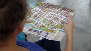 Holidays and Tourism Concept - Woman with Tourist Map in City