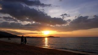 Honeymoon Couple Walking at Sunset. Newlywed Couple Enjoying Picturesque Seashore. Thailand.