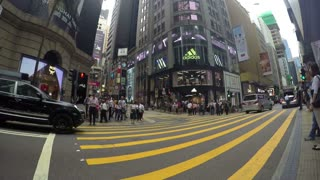 HONG KONG - SEPT 21: Business People in Downtown on Zebra Crossing. Timelapse.