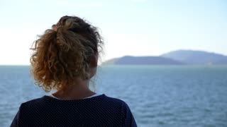 Inspirational and Uplifting Slow Motion Video. Girl Listening Music and Admiring the Seascape. Happy Serene Life.