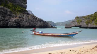 Koh Samui, Thailand, January - Longtail Boat in the Sea on Tropical Beach