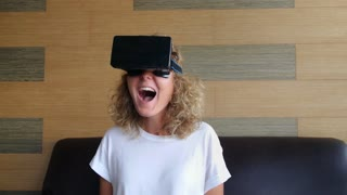 Laughing Woman in VR Glasses Excited in Virtual Reality