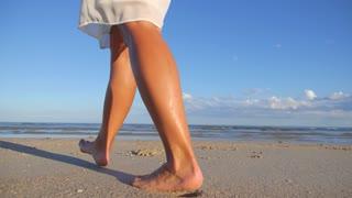 Lonely Girl Walking Barefoot Along Island Coastline at Sunset