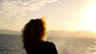 Lonely Woman Looking Sadly at the Sunset from the Sailing Ship. Slow Motion.
