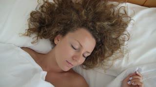 Loving Man Hand Waking Up Beautiful Young Woman