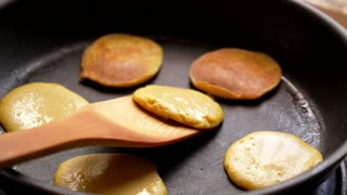 Making of Home Made Pancakes on Frying Pan. Turning over Flapjacks.