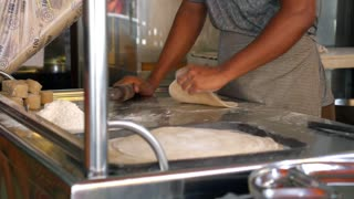 MALAYSIA, PENANG, 15.06.2015 - Woman Pinning out and Rolling Dough in Kitchen
