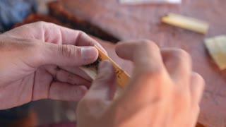Male Hand Rolling Cigarette Closeup